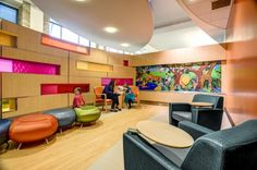 The waiting area for young children in the outpatient clinic. The jungle mural is a reproduction of the artwork used in the old clinic. Photo: Courtesy of GBBN Architects and JH Photography Inc. Hospital Architecture, Healthcare Architecture, Healthcare Design, Architecture Design, Waiting Room Design, Waiting Area, Waiting Rooms, Children's Clinic, L Office