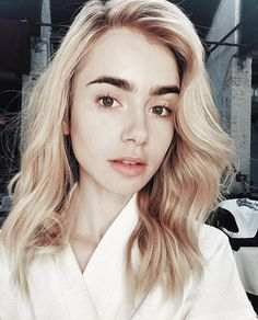 Lily Collins | blonde hair | bold brows