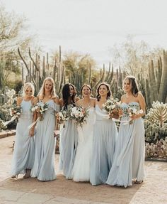 dusty blue wedding dresses for bride and bridesmaids, wedding bouquets, wedding hairstyles, wedding color palettes, outdoor wedding inspirations Light Blue Bridesmaid Dresses, Bridesmaid Dress Styles, Brides And Bridesmaids, Wedding Dresses, Beach Wedding Bridesmaids, Wedding Bouquets, Blue Wedding, Wedding Colors, Wedding Styles