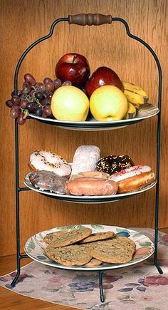 A tiered plate rack is a great way to serve desserts in a small place.....three different plates of dessert in one small space on the counter or table!