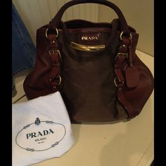 Spectacular AUTHENTIC PRADA saddle style handbag! Spectacular AUTHENTIC PRADA saddle style handbag!  Gently used in excellent shape with only one small spot on interior leather smaller than a dime.  This bag is large and gorgeous great for every day and travel!  Purchased brand-new at the Prada store in SoHo New York City! Prada Bags Shoulder Bags