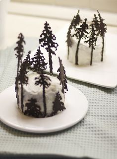 Pines in the snow cupcakes. This would actually be easy - melted chocolate, squirt bottle, wax paper.