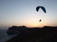 #OmanInPictures | Sunset Soaring at Eftaquot Beach. credit: Paragliding Oman. see on Fb https://www.facebook.com/SinbadsOmanPocketGuide #Oman #travel #paragliding #TravelToOman #Sinbad