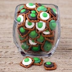 These would be fun for a Dr. Suess party day.  They look like green eggs and ham :) Cute & easy! Square pretzels, chocolate and green M 200 by aimee