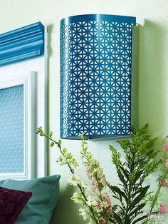 Use decorative sheet metal to dress up a plain sconce.