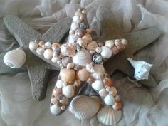 Star fish wall decoration with shells and sand