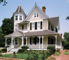 This Barber Queen Anne in Edenton, North Carolina, built in 1897, is handsomely designed and well-proportioned, with a notable veranda and another three-story octagonal tower.  Twin house just down scaled into a smaller version.....I like the yellow and white