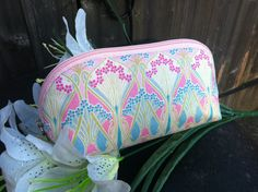 Oval Pale Pink Ianthe Cosmetics Bag. Curved waterproof lined handmade cosmetics bag. Made with quality cotton Liberty of London fabric by Melbourne Accessories