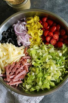 Italian Chopped Salad from afarmgirlsdabbles.com - an Italian salad loaded with fresh goodness, plus salami, provolone, pepperoncini, and olives. It's light, yet hearty, and extra flavorful with a zippy Italian vinaigrette! #salad #italian #chopped #lettuce #tomatoes #onion #salami #provolone #pepperoncini #olives