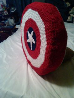 Captain America shield pillow, on the back is are handles & a strap so he can carry it around & use it as a shield.