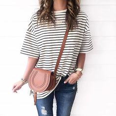 Pin for Later: 32 Lazy but Stylish Outfit Ideas For the Days You Just Don't Feel Like Trying An Oversized Striped Tee and Distressed Jeans
