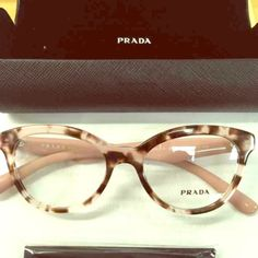 Prada glasses New Prada glasses with a light pink and turtoise frame. Never worn, comes with everything you see. Really pretty cat eye glasses Prada Accessories Glasses