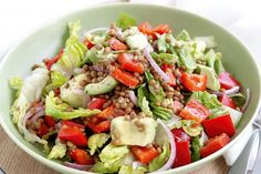 Take the best produce of summer produce and chop up a tasty salad of lentils and red capsicum.