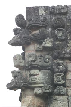 Masks of Chac the Rain God on a corner of Temple 22
