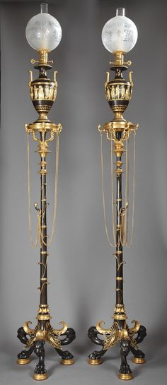 A pair of H. Cahieux and F. Barbedienne Neo-Pompeian patinated and gilt-bronze lamps, circa 1855.