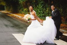 bride and groom running across the street by jenny gg