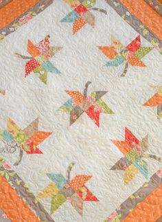 Love love love the fall leaves and colors of this quilt. Would make an awesome runner as well.
