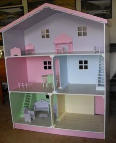 LARGE BARBIE DOLLS HOUSE - I'd make it prettier. Wallpaper the walls, find cute furniture, and stuff like that. We'd have like two or three so our kids and their cousins can all play
