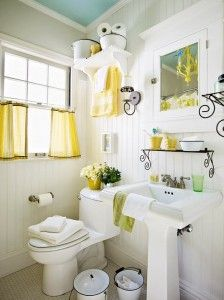 Like the mostly white bathroom with blue ceiling & bits of color.
