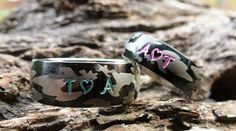 AWESOME...Stainless Steel Camouflage Ring Set. His is 8 mm wide and hers is 6 mm wide. Super durable stainless steel. Sample shows hunter vest orange paint inside the deep stamping. You may also add a date to the back. If you want just plain camo with no stamping please let me know in note to seller. I hand stamp each letter (on outside of the ring only) then use the best quality jewelry paint, bake, clean and polish. Available colors for camo rings are: Orange, pink, lime green, white, blue ... Camo Wedding Bands, Wedding Sets, Matching Couple Rings, Matching Couples, Camo Rings, Orange Pink, Hand Stamped, Camouflage, Stamping