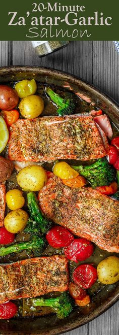 Za'atar Garlic Salmon Recipe | The Mediterranean Dish. Pan sheet garlic salmon with a Mediterranean twist you will love! Crusty zaatar, lemon juice, olive oil and veggies all on one sheet. Ready in 25 minutes! See the recipe on TheMediterraneanDish.com