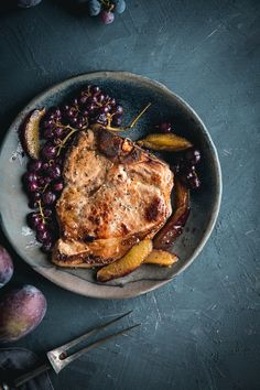 Perfect Brined Bone In Pork Chops with Roasted Grapes and Plums by Eva Kosmas F Plum Recipes, Meat Recipes, Savoury Recipes, Perfect Pork Chops, Breakfast Recipes, Dinner Recipes, Juicy Pork Chops, Easy Family Meals, Frugal Meals