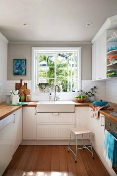 white-kitchen-timber-floorboards-grey-paint-stool-apr15 A coloured ceiling can open up a space, or bring a sense of intimacy if it's painted in the same colour as the walls