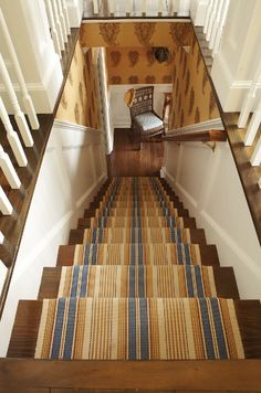 A striped stair runner picks up the colors of the interior's palette.