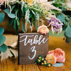 These wooden, hand-lettered table numbers are the definition of simplistic-elegance in its sweetest form! {Photo: @jenweinman; Handlettering: @chelsea_olson_}