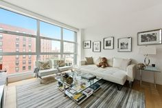 STATS 2 BEDROOMS 2 BATHS 935 SQ. FT. $2.45 MILLION Large studio-style windows allow for plenty of natural light to shine into the living room of model Gigi Hadid's Manhattan home. The apartment, in the SoHo neighborhood, was decorated with the help of her mother, Yolanda Hadid Foster, of The Real Housewives of Beverly Hills. Contact: Fredrik Eklund, 212-727-6158, and John Gomes, 212-891-7676, both of Douglas Elliman Real Estate; elliman.com