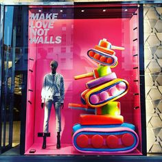 """DIESEL, Barcelona, Spain, """"Make Love Not Walls"""", photo by Wowindow, pinned by Ton van der Veer Fashion Window Display, Window Display Design, Shop Window Displays, Retail Windows, Store Windows, Advertising Techniques, Behind The Glass, Exhibition Display, Visual Display"""