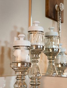 3 Easy DIY Projects for a Small Bathroom Upgrade. These jars are so simple and made elegant by the stands.