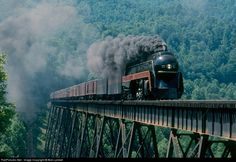 Norfolk & Western J Class steam locomotive is seen is seen heading northbound over the Trace Fork Branch trestle with an excursion at Amonate, VA in June The 611 was built in the N&W's Roanoke Shops in Old Steam Train, Railroad History, Southern Railways, Norfolk Southern, Train Pictures, Old Trains, Train Engines, Steam Engine, Steam Locomotive