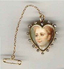 Hand painted miniature on ivory pendant brooch with 14 cushion-cut diamonds, 15 K gold, c 1890.
