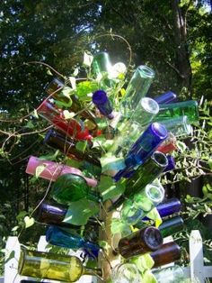 "A Bottle Tree For My Garden ""Reuse of Junk"" How To Make A Bottle Tree."