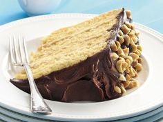 The peanut butter-whipped cream filling in this yellow cake is smooth as silk. Better yet: It's surrounded by fluffy yellow cake from a mix and a rich chocolate frosting. Instead of peanuts, you can garnish with cut-up peanut butter cups.