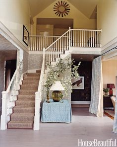 In this entrance hall, designer Jeffrey Bilhuber used a rectangular table skirted in a custom fabric by John Robshaw.   - HouseBeautiful.com