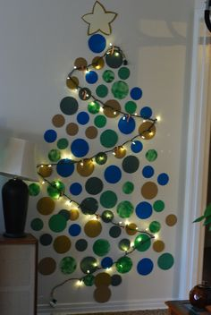 No space for a tree? Construction paper, a string of lights, tape and thumbtacks. boom.