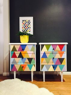 'Number 32' pair of rehashed 1970s triple drawer bedside tables. Casing and slimline legs in semi gloss white enamel. Tri Geometric pattern to drawer fronts hand painted and sealed. Drawers slide perfectly and have been dressed with new black metal barrel knobs.