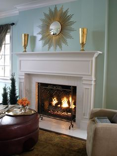 White Brick Fireplace and Blue Green Wall with Decorative Wall Mirror - on HGTV