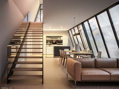 On the bottom floor, which is set 'below ground' and opens up to the cliff-face, is the open-plan kitchen and lounge area