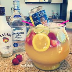 THE TROPICAL FISHBOWL MARGARITA ~ 6 oz. (180ml) Tequila, 3 oz. (90ml) Coconut Rum, 2 oz. (60ml) Triple Sec, 2 oz. (60ml), Peach Schnapps, 1 oz. (30ml) Lime Juice, 6 oz. (180ml) Pineapple Juice, Bottle of Orange Juice, Orange Slices, Lime Slices, Strawberries, 24 oz. Corona Beer Bottle