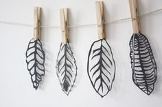 Paper Cut Leaves.  i think this would be a good thing for a first attempt at paper cutting
