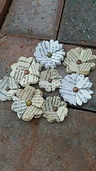 Here at Cornerhouse 115 we make all our own paper flowers.Today I'm going to be sharing with you all how to make,what we call 'Ava' flowers. We named the flowe Avas Flowers, Paper Flowers, Folded Book Art, Book Folding, Paper Crafts, Diy Crafts, Paper Ornaments, Paper Cupcake, Paper Flower Tutorial