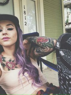 Tattoos girl arm chest flowers