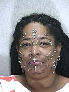 OCALA -- Cops pull over woman for driving toward their car with her high-beams on, find that she's got pot and pills....and 30 facial piercings. (November 2014) Tragus Piercings, Mug Shots, Poker