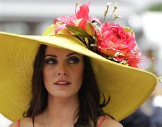 Tamara Sorrell, from Austin, Tx., wears a fancy hat in the paddocks before the 138th Kentucky Derby horse race at Churchill Downs Saturday, May 5, 2012, in Louisville, Ky.