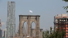 German Artists Say They Put White Flags on Brooklyn Bridge  it does look scary, like someone conquered the brooklyn bridge in our sleep. no just artists