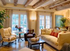 French farmhouse living room living room eclectic with leather chair cream couch