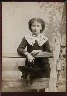 African American girl  (Bi-racial) at fence with hat, via Flickr